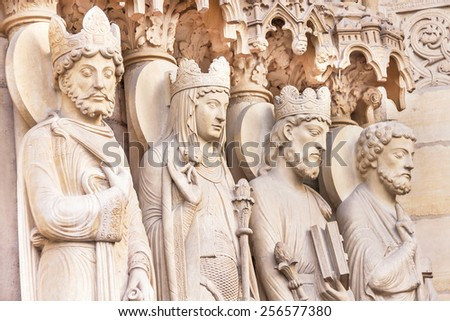 Paris, France - January 9, 2015: Notre Dame de Paris cathedral. Architectural details (statues). Notre Dame one of the most famous landmarks in Paris. France. Travel (vacation), architecture concept. - stock photo