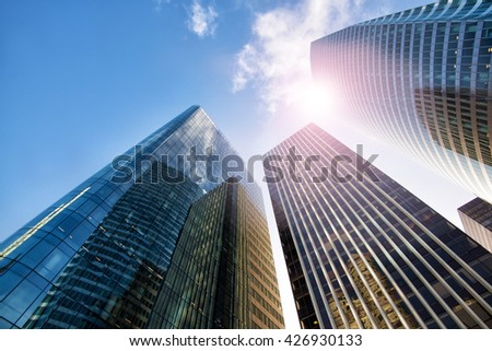 PARIS, FRANCE - January 4, 2016: skyscrapers seen from below in the business district of Defanse. Defense is the largest business district in France and most of the big companies have offices here