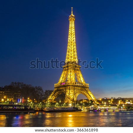 Paris, France-January 21, 2016: The Eiffel tower is one of the most visited monument in the world located on the bank of Seine river in Paris, France. - stock photo