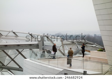 PARIS, FRANCE - JANUARY 5, 2015: Tourists visiting the Fondation Louis Vuitton arts center - stock photo