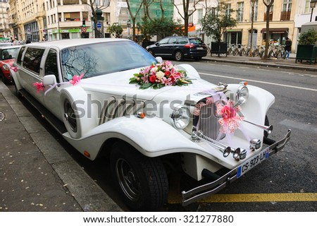 PARIS, FRANCE - JANUARY 4, 2015: Wedding limousine at Parisian street. Paris is one of the most popular destinations for wedding and honeymoon.