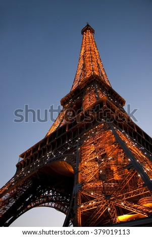 PARIS, FRANCE - JULY 17, 2010: Bottom-up view to illuminated Eiffel tower.