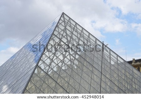 PARIS, FRANCE -1 JULY 2016- Built in 1989, the Pyramide du Louvre is a glass pyramid designed by architect I. M. Pei in the Cour Napoleon main courtyard in the Louvre Museum in Paris. - stock photo