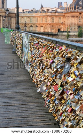 PARIS, FRANCE - JULY 23, 2013: Closeup view of the hundreds of thousands of love inscribed padlocks on the Pont Des Arts Bridge. - stock photo