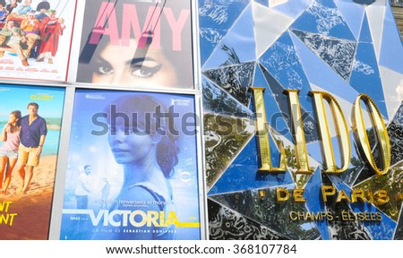 Paris, France - July 9, 2015: Detail of billboard displaying movies shown at the Lido cinema on Champs Elysees, Paris, France - stock photo