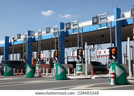 PARIS, FRANCE - JULY 3, 2014: Drivers pay road toll for using the highway A10. July 3, 2014 in Paris, France.  - stock photo