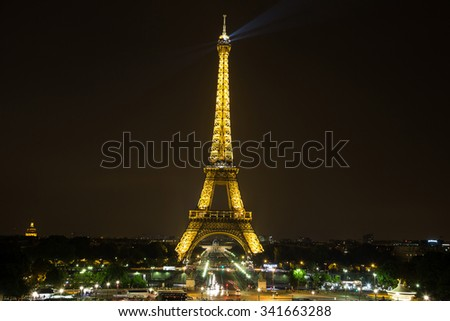 PARIS, FRANCE - JULY 14 2014: Eiffel Tower at night is the most visited monument in France and the most famous symbol of Paris, July 14, 2014 - stock photo