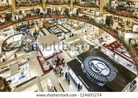 PARIS, FRANCE - JULY 15: Galleries Lafayette Haussmann in Paris, France - Department Store (14000 sq. meters) with leading international collection (260 brands) of chic and bold, on July 15, 2012 - stock photo