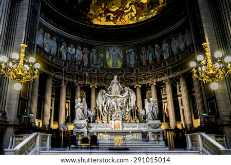 PARIS, FRANCE - JULY 14, 2012: Interiors and architectural details of Eglise de la Madeleine. Madeleine Church was designed in its present form as a temple to the glory of Napoleon's army. - stock photo