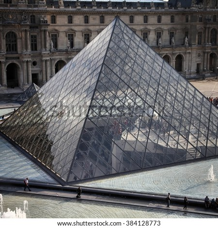 PARIS, FRANCE - JULY 22, 2011: Louvre pyramid in Louvre Museum, Paris, France. With 8.5m annual visitors, Louvre is consistently the most visited museum worldwide.