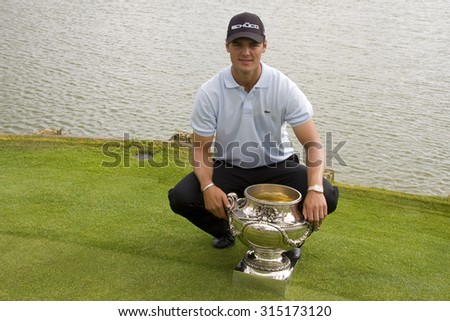 PARIS FRANCE, 05 JULY 2009. Martin Kaymer (GER) poses with the trohy after winning the PGA European Tour Open de France golf tournament. - stock photo