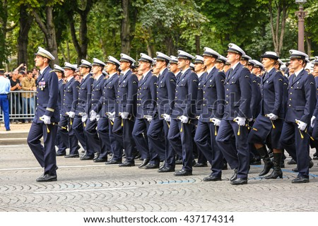 PARIS, FRANCE - JULY 14, 2014: Military parade (Defile) during the ceremonial of french national day, Champs Elysee avenue. - stock photo
