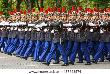 PARIS, FRANCE - JULY 14, 2014: Military parade (Defile) during the ceremonial of french national day, Champs Elysee avenue.