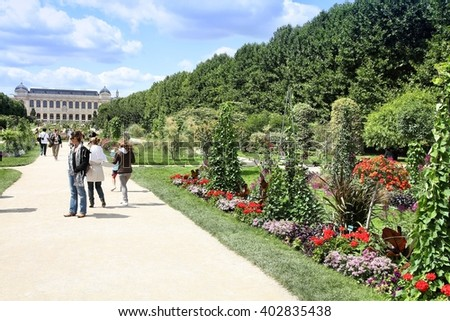 PARIS, FRANCE - JULY 24, 2011: People stroll in Garden of Plants in Paris, France. Garden of Plants is popular among tourists in Paris, most visited city worldwide (15.6 m int'l arrivals in 2011).