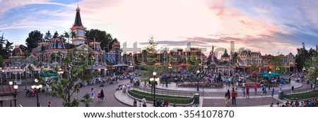 PARIS, FRANCE, July 19: Square with people in front of the main entrance to the Disneyland Paris 19 July 2010. Disneyland Park, one of the attractions of Paris. - stock photo