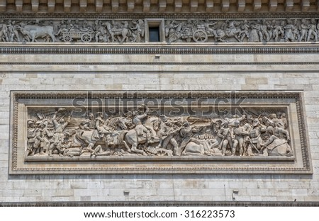PARIS, FRANCE - JULY 9, 2015: The Arc de Triomphe detail with Battle of Jemappes, is the famous monument that honors those who fought and died for France.