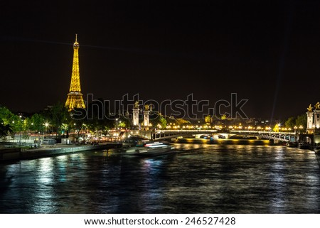 PARIS, FRANCE - JULY 14 2014: The Eiffel Tower and Pont Alexandre III at night in Paris, France, July 14, 2014