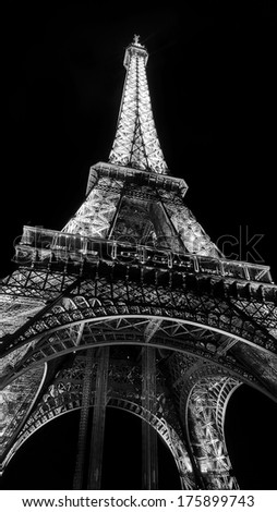 PARIS, FRANCE -  JULY 15 2013: The Eiffel Tower (La Tour Eiffel) is an iron lattice tower located on the Champ de Mars in Paris - In black and white