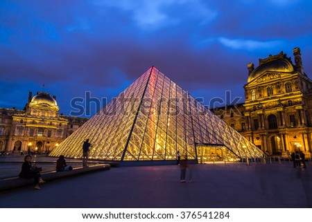PARIS, FRANCE - JULY 14 2014: The Louvre at night is one of the world's largest museums  in Paris, July 14, 2014 - stock photo