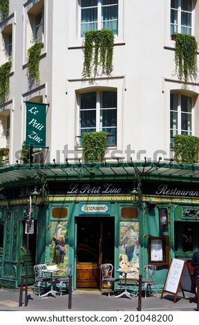 Paris, France - July 14, 2011 - The quaint Le Petit Zinc restaurant on the Left Bank of Paris. The superb cuisine draws millions of tourists to Paris each year.