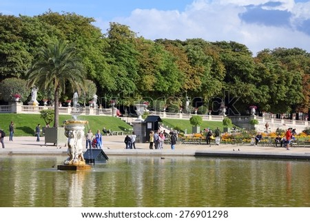 PARIS, FRANCE - JULY 23, 2011: Tourists visit Luxembourg Gardens in Paris, France. Paris is the most visited city in the world with 15.6 million international arrivals in 2011. - stock photo