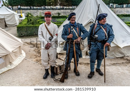 PARIS, FRANCE - JULY 14, 2014: Tuileries garden: People in historic World War I uniforms on French National Day (Bastille Day) in Paris commemorating 100th anniversary of the beginning of World War I.