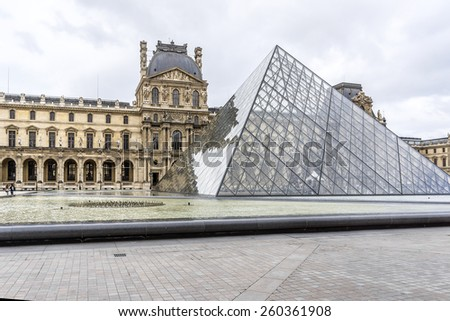 PARIS, FRANCE - JULY 13, 2014: View fragments of Louvre buildings and Glass pyramid in Louvre Museum. Louvre is one of the largest and most visited museums worldwide. - stock photo