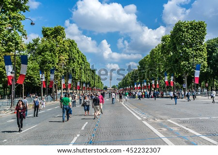 PARIS, FRANCE - JULY 14, 2014: View of Champs-Elysees - most famous avenue of Paris has 1910m. First and only on holiday - French National Day (Bastille Day) Champs-Elysees steel pedestrian.