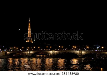 PARIS, FRANCE - JULY 18, 2010: View to the bridge, Eiffel tower and Moon at nighttime.