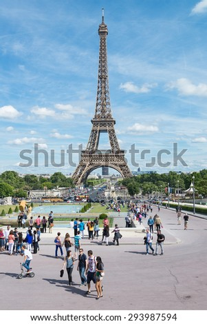 PARIS, FRANCE -  JUN 21, 2015 : Everyday scene of tourists around Eiffel tower from Trocadero. The Eiffel Tower is the most visited landmark in France. - stock photo