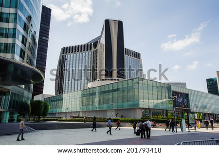 PARIS, FRANCE - JUN 18, 2014: Modern glass architecture of the La Defense district. La Defense is the major business district of the Paris, France