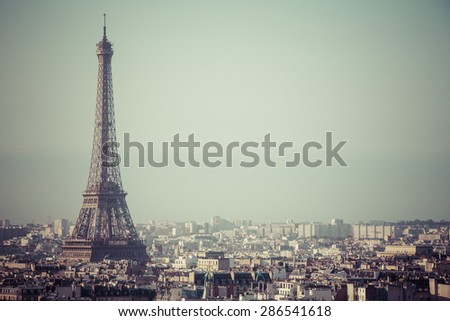 PARIS FRANCE-JUNE 6,2015:Aerial view of the Eiffel Tower in Paris, France in a beautiful summer day, process color - stock photo