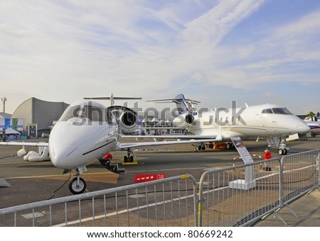 PARIS, FRANCE - JUNE 24:Bombardier Challenger 300 and Challenger 850 displayed at the International Paris Air Show. June 24, 2011 Le Bourget Airport, France.