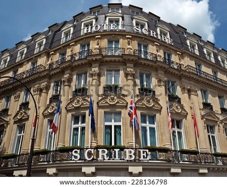 PARIS, FRANCE - JUNE 11, 2014: Building of the Hotel Scribe. Located in the Opera district, close to Place Vendome in a beautiful historic building where in 1895 the Lumiere brothers invented cinema.  - stock photo