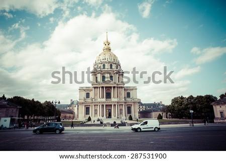 PARIS, FRANCE -JUNE 2: Chapel of Saint Louis des Invalides on June 2, 2015 in Paris. Chapel built in 1679 is the burial site for some of France's war heroes, notably Napoleon Bonapart, process color. - stock photo