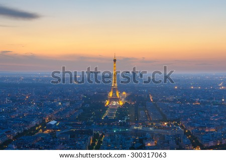 Paris, France - June 20, 2015: cityscape of paris in the dusk with eiffel tower from Montparnasse Tower on June 20, 2015