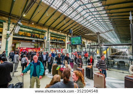 PARIS, FRANCE - JUNE 1, 2015: Commuters in Gare du Nord station in Paris, with national and international destinations, it is the busiest railway station in Europe - stock photo