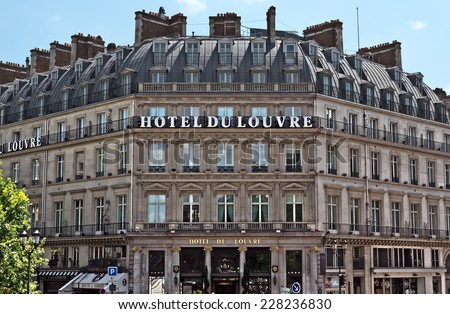 PARIS, FRANCE - JUNE 11, 2014: Facade of the Grand Hotel du Louvre, Hyatt Hotel in Paris. Located near Louvre Palace in a beautiful historic building builted in 1895.  - stock photo