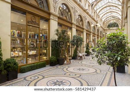 PARIS, FRANCE - JUNE 1, 2016: Galerie Vivienne (1823). Vivienne Covered Passage is 176 metres long, with shops, restaurants and tourist attraction.French Antique life.