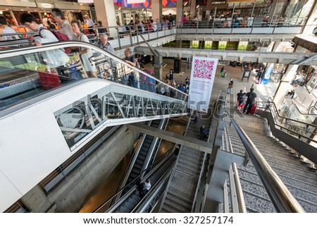 PARIS, FRANCE - June 13, 2014: Interior view of Paris Montparnasse TGV train station people using escalators and stairs. - stock photo