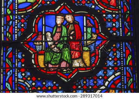 PARIS, FRANCE - JUNE 1, 2015 Jesus Mary Joseph Stained Glass Saint Chapelle Paris France.  Saint King Louis 9th created Sainte Chapelle and stained glass in 1248. - stock photo