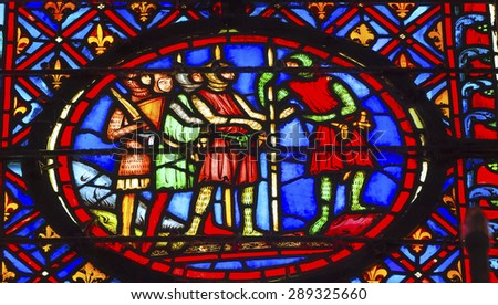 PARIS, FRANCE - JUNE 1, 2015 Knights Medieval Life Stained Glass Saint Chapelle Paris France.  Saint King Louis 9th created Sainte Chapelle and stained glass in 1248. - stock photo