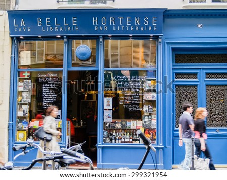 PARIS, FRANCE - JUNE 21; La belle Hortense famous wine bar and bookshop in Marais District Paris France with people walking past the open door on June 21, 2009 in Paris France.