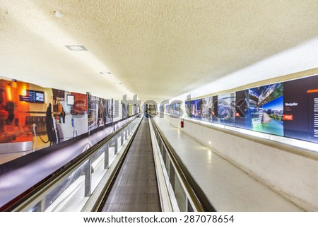PARIS, FRANCE - JUNE 13, 2014: long moving staircases in Terminal 1 at airport Charles de Gaulle in Paris, France. In 2013, the airport handled 62,052,917 passengers. - stock photo