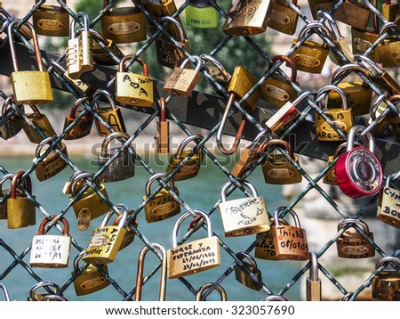 PARIS, FRANCE - JUNE 13, 2013: Love lockers at Pont des Arts (Passerelle des Art) symbols of endless love and commitment forever be together. - stock photo