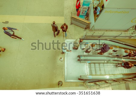 PARIS, FRANCE - JUNE 1, 2015: Passengers in the electric escalators in the Gare du Nord station in Paris, the busiest railway station of Europe. Aerial view - stock photo