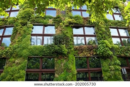 PARIS, FRANCE - JUNE 9: Quai Branly Museum on June 9, 2014 in Paris, France. The green wall on part of the exterior of the museum was designed and planted by Gilles Clement and Patrick Blanc.  - stock photo
