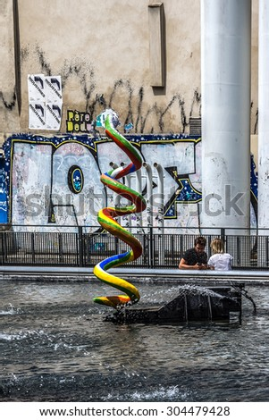 PARIS, FRANCE - JUNE 12, 2015: Stravinsky Fountain (1983) is a fountain with 16 works of sculpture, moving and spraying water, representing works of composer Igor Stravinsky. Place Stravinsky, Paris.