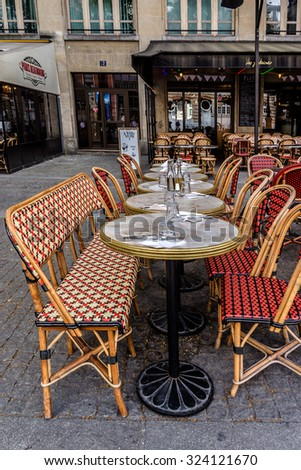 PARIS, FRANCE - JUNE 2, 2015: Street view of a typical outdoor coffee terrace with tables and chairs near Centre Georges Pompidou.