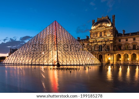 Paris, France - June 7th, 2014: The Louvre museum, Paris, at twilight, one of the major tourist attractions in France and in Europe - stock photo